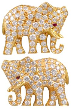 Cartier Diamond Elephant Earrings, circa 1960's. Rare figural 18k gold elephant earrings signed and numbered Cartier. 5.50cts of full cut diamonds; faceted ruby eyes. Via 1stdibs.