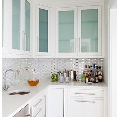 Genial Stunning Contemporary Butleru0027s Pantry Design With White Inset Cabinets With  Creamy White Crown Moldings.    The White Quartz With Frosted Glass And THE  ...