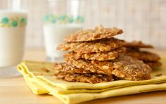 Maple-Oat Cookies // Toasting the oats adds great flavor to these simple oat cookies, sweetened with maple syrup and flavored with warm spices. Package in cute container and give as a Valentine's Day gift to your loved ones! Enjoy them with coffee on a weekend morning and warm milk at the end of the day.