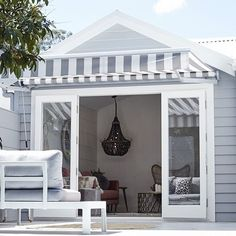 Cladding goals This neat little renovation by is the modern cottage you'd always wished you had complete with screen for privacy striped awning and some well chosen outdoor pieces. Grey Exterior, Exterior House Colors, House Awnings, Patio Awnings, Window Awnings, Pool House Decor, Patio Deck Designs, Patio Decks, Patio Design