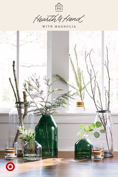 Mixing vases of varying heights is a great way to add dimension. Use one or two sprigs for an added touch of whimsy, bringing the space to life. Hearth & Hand™ with Magnolia, only at Target.