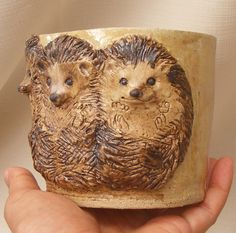 Stoneware Tree hedgehogs attached relief hedgehogs