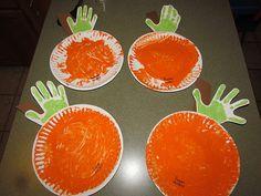 Handprint Pumpkins. I say add a jack-o-lantern face with cut black constructions paper shapes glued down