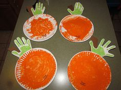 Handprint Pumpkins. I say add a jack-o-lantern face with cut black constructions paper shapes glued down