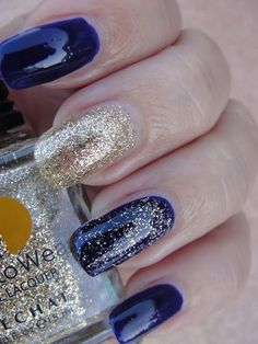 Dark blue nails with gold glitter nail polish. LeChat Moon Goddess Collection Review