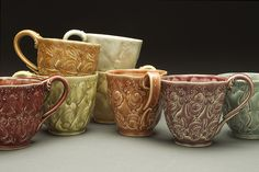 Stamped cups w. birds and rabbit by Kristen Kieffer, via Flickr