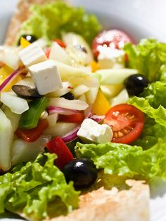 This fresh and tasty Greek Salad Sandwich can be eaten with a pita or served open-face on naan.