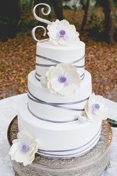 Swindasz-Swanson Wedding Cake! Orange cream cake with custard filling and whipped cream frosting. Silver ribbon and sugar magnolias. Magnolia Wedding Cake.