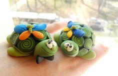 turtles out of polymer clay - but could make out of fondant 4 cake topper just as easily