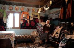 Romanian woman in her home, surrounded by house-made items, photo by Cornel Pufan - Pixdaus