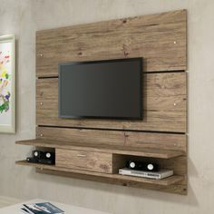 Manhattan Comfort Ellington Floating Entertainment Center - Banish clutter with the impeccably clean design of the Manhattan Comfort Ellington Entertainment Center. Your space greatly affects your state of m...