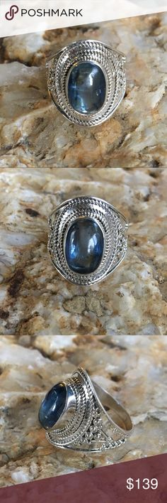 Genuine kyanite artisan made solid sterling ring Beautiful blue, genuine kyanite cabochon set in an intricately handcrafted, artisan designed solid sterling silver ring. Variations in natural stones and artisan crafting make this ring one of a kind. Jewelry Rings