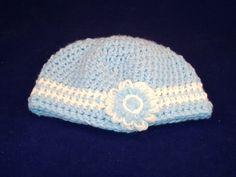 Toddler Crocheted Hat, Blue and White Flower on Bowl Hat. $10.00, via Etsy.