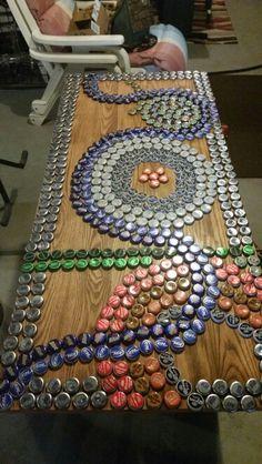 Bottle cap mosiac coffee table.