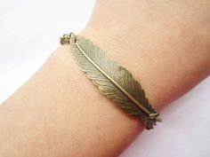 braceletantique bronze feather pendant chain by lightenme. $2.99, via Etsy.