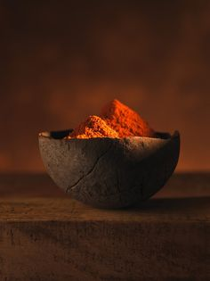 This looks like it could be pimenton or even espelette pepper. We like the contrast of dark and light. A very warm photo reminding us of comfort food. Ground mild red pepper