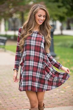 We adore this beautiful twist on a classic plaid dress!