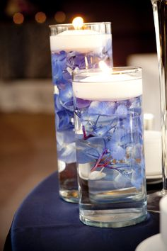 Submerged blue hydrangeas under floating twinkle candles