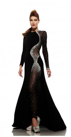 See the galaxy when you don this celestial gown from Johnathan Kayne 6093 by Joshua McKinley. A mature neckline is fantastic with fitted long sleeves. Long Sleeve Evening Gowns, Long Sleeve Gown, Black Long Sleeve Dress, Dress Long, Long Gowns, Sleeve Dresses, Dress Black, Designer Prom Dresses, Ballroom Dress