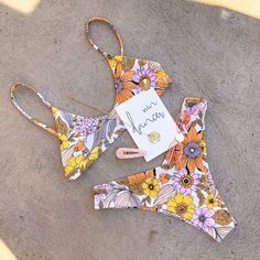All you need is faith, trust & a little bit of 'Pixie' dust... With a stone-white (soft hues of sliver) base, this Kini blossoms with warm, soft Australian natives.