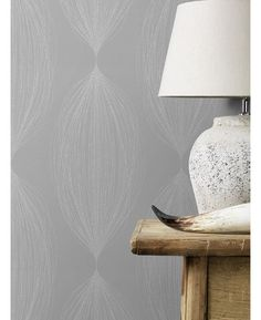 This Sparkling Glitter Linear Leaf Wallpaper features interwoven silver glitter strands in an abstract pattern on a lightly textured taupe background. Free UK delivery available