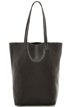 This bag should be large enough to carry your essentials and sturdy enough for everyday wear and tear. Baggu's totes are amazing and can handle that heavy-as-a-brick MacBook you've carried around for a decade.  Baggu Basic Tote, $160; shopbop.com    - ELLE.com