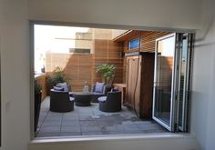 A gorgeous patio located in Gastown with a bi-folding patio door