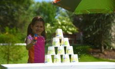 8/9/14 Use a squirt gun to topple a cup pyramid.  Wind was a little problem, but fun game!