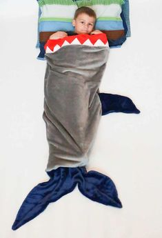 Can you believe we are already on Day 8 of our 12 Days of Christmas Freebies!? Last year, one of our most popular freebies was the Mermaid Tail Blanketand we have received countlessrequests for a modification toturn the Mermaid Tail into a shark. We've heard your cries, so today we are bringing you a free ... Read More about Shark Tail Blanket for Kids & Dolly