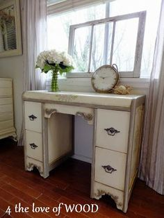 "$360 COCO AND OLD WHITE DESK 29.5"" tall x 17"" deep x 36"" wide aged old white with coco trim and hand painted floral designs, 4 deep drawers with  reproduction handles, hand waxed finish, embellished with several carved appliques"