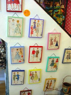 Vintage sewing patterns in picture frames - displayed on kid wall.