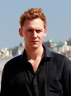 Tom, red hair, navy shirt