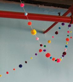 Make a garland to stretch from window to door above Luna's bed (Pompoms and mobile hanging in middle above bed)