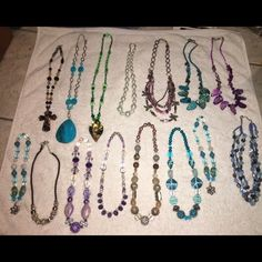 15 variety colorful necklaces Swarovski crystals All different lengths, some stretchy, some choker length, some long, crystal crosses, Swarovski crystals, pearls, precious stones, purple amethyst lab created, beautifully crafted necklaces. Great deal selling in a lot of 15 all together. Variety Jewelry Necklaces