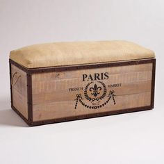 The Paris Storage Trunk looks like it's just arrived by ocean liner from France. It's crafted of a durable combination of mango wood and iron. The trunk's lift-off top is upholstered in natural burlap with a rustic finish.