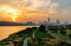 Sunset over Han River Park with the skyline of Yeouido in the distance Seoul South Korea [42882848]
