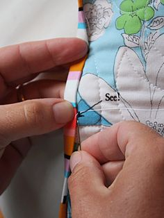 GREAT instructions on how to hand sew quilt binding.