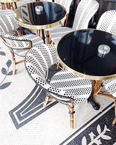 Small round table, big statement chairs. Small dining space made chic. More