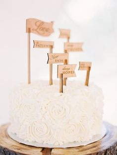 I used these custom cake sticks for the wedding of a blended family. Such a great way to involve children in a personal touch.  The sweetest cake: http://www.stylemepretty.com/little-black-book-blog/2015/04/24/blush-alberta-dairy-farm-wedding/ | Photography: Justin Milton - http://milton-photography.com/