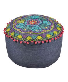 Add a burst of global flavor to the decorating scheme with a colorful cushion. This plush piece's delightful design and denim construction are sure to complement any room while making an ideal comfy-time companion.8'' H x 16'' diameterDenimSpot cleanImported