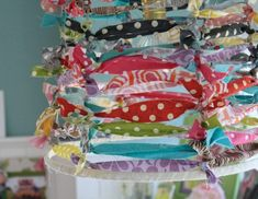 raw lampshade, finished with strips of fun fabric. would look awesome in school room.