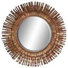 """Starburst wall mirror with a metal strip frame.Product: Wall mirrorConstruction Material: Mirrored glass and metalColor: Antique brown frameFeatures: Metal strips radiating from the center of the mirrorDimensions: 34"""" Diameter x 2"""" D"""