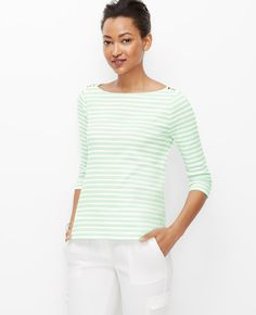 Tee time: we love the clean lines, covetable colors and shoulder button detail of this can't-live-without style. Boatneck. 3/4 sleeves. Side slits.