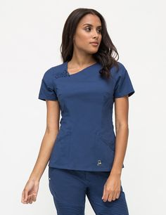 The Asymmetric Top in Estate Navy Blue is a contemporary addition to women's medical scrub outfits. Shop Jaanuu for scrubs, lab coats and other medical apparel.