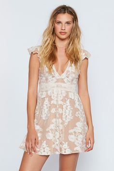 Temecula Fit And Flare Dress   **See above for the For Love & Lemons size chart to find your best fit.**  Femme fit-and-flare mini dress featuring a pretty, sheer overlay with an embroidered design.    * Ruffled cap sleeves   * Crochet trims and waist detail   * Deep V-neckline   * Hidden side pockets   * Hidden back zipper closure   * Lined