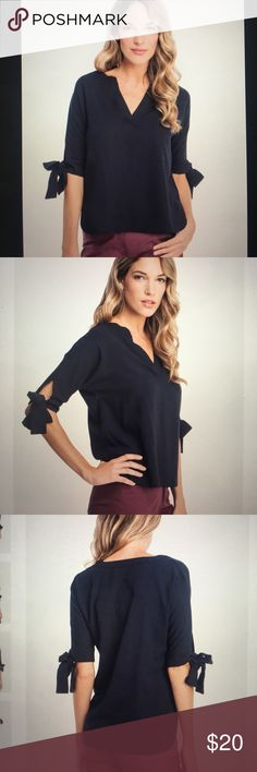 Glamorous asos bow top Glamorous brand bow top (UK brand, I can't remember but probably purchased at asos or Nordstrom- they both carry the brand). Polyester. Black. Great condition. Glamorous Tops