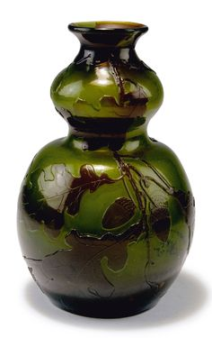 Emile Gallé, Nancy. 'Chêne lorrain' vase de tristesse, c1900. H. 22.5 cm. Cased glass, bottle green, clear and amber. Deep blue combed powder inclusions (salissures intercalaires). Multiply etched pattern with oak leaves and acorn. Inside matted. Signed: Gallé 16.     SOLD 3,500 EUR, 2015