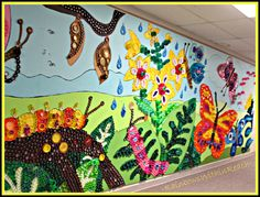 Up-Cycled Art: Wall murals at an Ohio elementary school made of plastic lids and caps, which are NOT recyclable items. :(  Great way to divert waste from the landfill and create beauty from it!