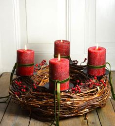 advent wreath made of meadow and red vintage candles