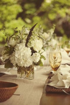 Super chic hint: Add feathers to any centerpiece! It doesn't have to be a huge ostrich feather (though I love those too)...just a small pheasant feather non-nonchalantly placed in a vase of flowers looks amazing!
